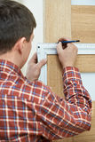 Carpenter at door installation Stock Photos
