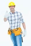 Male handyman gesturing thumbs up sign Royalty Free Stock Image