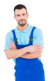 Male handyman standing arms crossed Stock Images