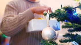 Male hanging balls on the Christmas tree stock video