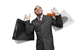 Male happy shopping. Happy male business man wearing sunglasses doing shopping Stock Photo