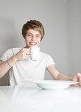 Male eating breakfast Stock Image