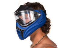 Male head in blue paintball mask on white background. Man has curly dark hair Stock Photos