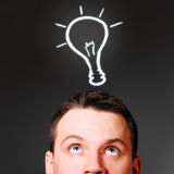 Male head with bulb. Idea concept Stock Photography