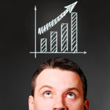 Male head with rising bar chart Stock Images