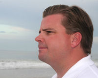 Male head shot. Middle aged male head shot with the ocean in the background Royalty Free Stock Photography
