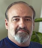 Male head shot with a serious look. royalty free stock photography