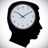 Male head silhouette with watch instead of brains. Stock Images