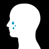 Male head with tears. Conceptual illustration of the silhouette of a male head with tears running down its cheeks conceptual of loss, bereavement, sorrow Royalty Free Stock Photography