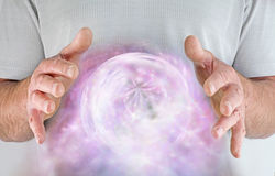 Male healer with whirling energy formation Royalty Free Stock Images