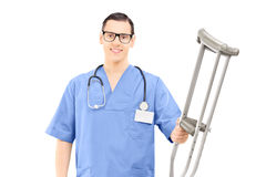 Male healthcare professional holding crutches Stock Photo