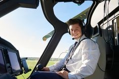 Portrait Of Male Helicopter Pilot In Cockpit Before Flight stock photos