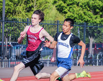 Male High school athletes run 200 meter race in track meet Stock Photography