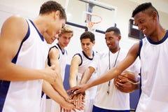 Male High School Basketball Team Having Team Talk With Coach. In Gymnasium Royalty Free Stock Photo
