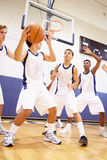 Male High School Basketball Team Playing Game. Image Of Male High School Basketball Team Playing Game In Gymnasium Stock Photography