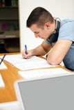 Male high school student in classroom Royalty Free Stock Photos