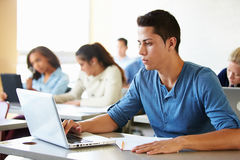 Male High School Student Using Laptop In Class Royalty Free Stock Photos