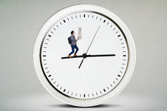 Male high school student walking on the clock Stock Photos