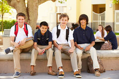 Male High School Students Hanging Out On School Campus. Smiling At Camera Stock Photo