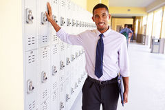 Male High School Teacher Standing By Lockers royalty free stock images