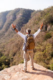Male hiker arms open. Senior male hiker with arms open on top of the mountain royalty free stock photo