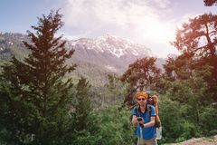 Man hiker on the lycian trail to Olympos mountain, Turkey. Male hiker on the background of Tahtali mountain on a sunny day Royalty Free Stock Photos