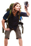 Male hiker with backpack and camera posing isolated Stock Images