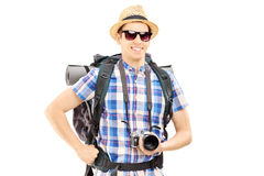 Male hiker with backpack and camera posing Stock Photo