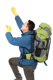 Male hiker with backpack climbing Royalty Free Stock Photos