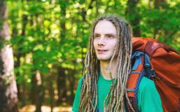 Male hiker with backpack. Trekking through the forest Stock Images