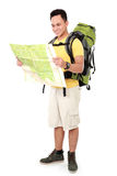 Male hiker with backpack and map Stock Images