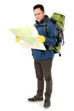 Male hiker with backpack and map Royalty Free Stock Image