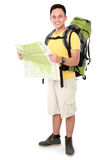 Male hiker with backpack and map Royalty Free Stock Photo