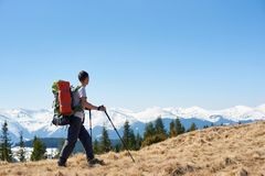 Male hiker with backpack in the mountains. Full length shot of a male backpacker with a backpack hiking in the mountains copyspace landscape view beauty Royalty Free Stock Photo