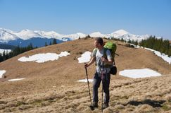 Male hiker with backpack in the mountains. Full length shot of a man with backpack walking mountains enjoying the view copyspace nature travelling achieving Royalty Free Stock Photography