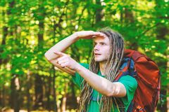 Male hiker with backpack pointing at something ahead. In the forest Royalty Free Stock Images