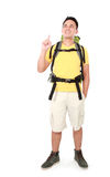 Male hiker with backpack pointing up Stock Photo