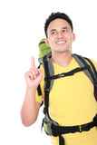 Male hiker with backpack pointing up Royalty Free Stock Photos
