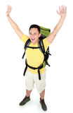Male hiker with backpack raised his arm Royalty Free Stock Image