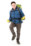 Male hiker with backpack raised his arm Stock Photos