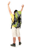 Male hiker with backpack raised his arm Royalty Free Stock Images