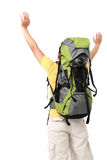 Male hiker with backpack raised his arm Royalty Free Stock Photos