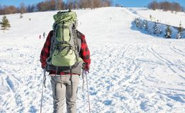 Male hiker on snow covered mountain. Male hiker with backpack on snow covered mountain Royalty Free Stock Image