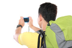 Male hiker with backpack using mobile phone Stock Image