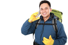 Male hiker with backpack using mobile phone Stock Images