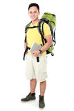 Male hiker with backpack using tablet computer Royalty Free Stock Images