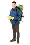 Male hiker with backpack using tablet computer Royalty Free Stock Photo