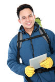 Male hiker with backpack using tablet computer Royalty Free Stock Photography
