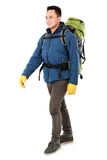 Male hiker with backpack walking Royalty Free Stock Photos