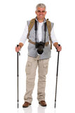 Male hiker with camera. Portrait of middle aged male hiker with camera stock photography